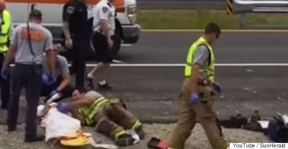 Fireman Comforts Little Boy After Car Crash By Playing 'Happy Feet' On His