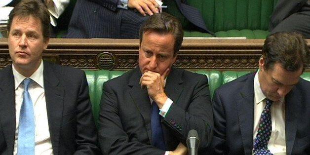 Prime Minister David Cameron, Deputy Prime Minister Nick Clegg (left) and Chancellor George Osborne (right)...