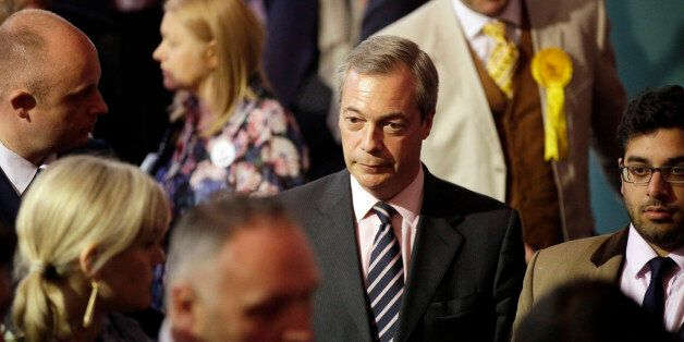 Nigel Farage, leader of the U.K. Independence Party (UKIP), center, waits for the results for the constituency...