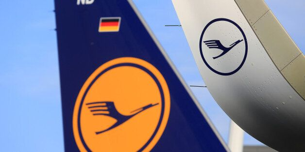 The Deutsche Lufthansa AG logo sits on the wing and tailfin of an Airbus A320neo aircraft during a delivery...