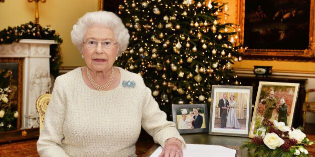 EMBARGOED TO 0001 LOCAL TIME Friday December 25, 2015. Queen Elizabeth II sits at a desk in the 18th...