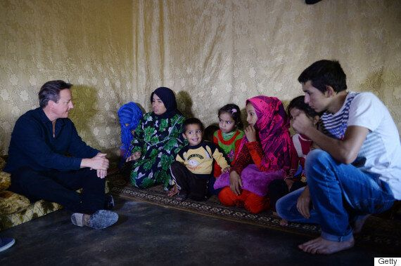 David Cameron Visits Syrian Refugees In Lebanese Camp But Little Boy Totally Steals The