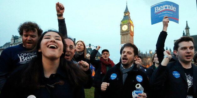 Supporters of democratic candidate Bernie Sanders gather in London, Tuesday, March 1, 2016 as voting...
