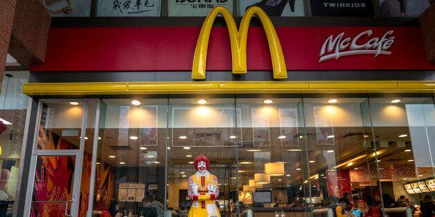 TIANJIN, CHINA - 2016/02/21: A figurine of Ronald McDonald stands outside a McDonald's restaurant. McDonalds...