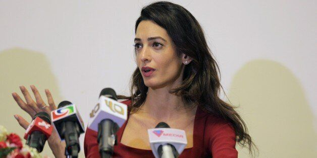 Human rights lawyer Amal Clooney speaks at a press conference at the Kurumba Maldives resort in the Maldives...