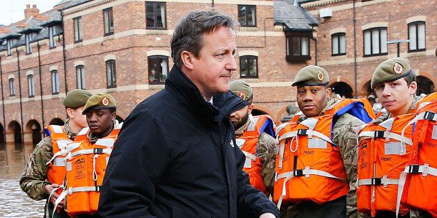 Prime Minister David Cameron greets soldiers working on flood relief in York city centre after the river...