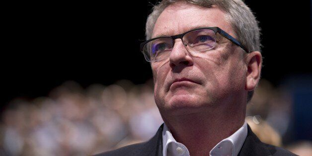 Australian political strategist Lynton Crosby listens to Conservative London Mayoral candidate Zac Goldsmith...