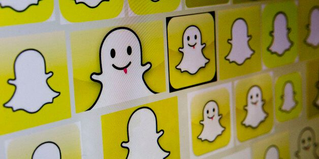 Snapchat Inc. logos are displayed on a laptop computer in Washington, D.C., U.S., on Wednesday, Feb....