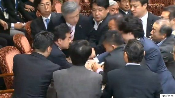 Japanese Politicians Scuffle In Parliament Over Debate About