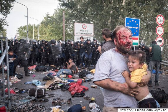 Refugee Crisis: Graphic Images Show People Hit With Tear Gas And Water Cannon By Hungarian