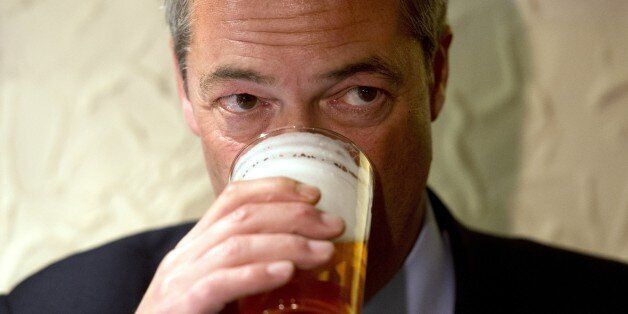 Nigel Farage, leader of the UK Independence Party (UKIP), enjoys a pint of beer in The Gardeners Arms...