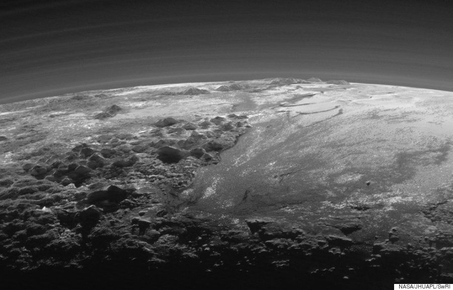 NASA's New Horizons Images Of Pluto Reveal Its 'Surprisingly Earth-Like'