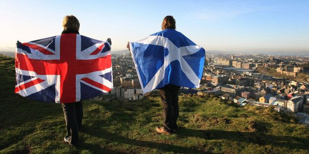 Scottish and English flags held up over Edinburgh,