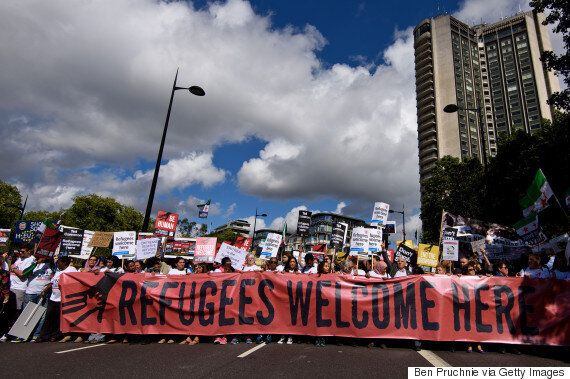 Britain's 'Refugee Welcome Board' Is A Far Cry From Europe's Closed Borders And Razor-Wire