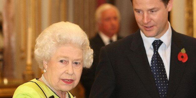 LONDON - NOVEMBER 11: Queen Elizabeth II speaks to Deputy Prime Minister Nick Clegg at the annual Civil...