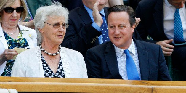 Britain's Prime Minister David Cameron, front right, and his mother Mary arrive to watch Andy Murray...