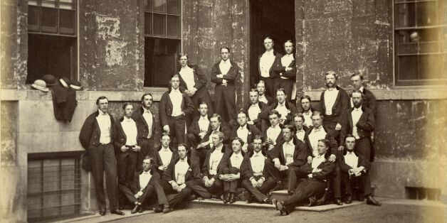 Charles Cecil Cotes, the album compiler, is standing at far left. Standing at back in the corner with...