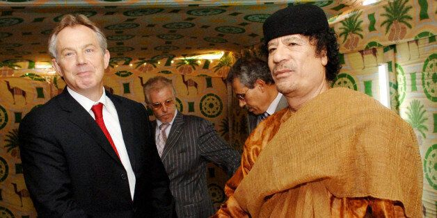 File photo dated 29/05/07 of Tony Blair (left) and Colonel Gaddafi shaking hands at Gaddafi's desert...