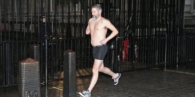 Daily Telegraph political journalist Dan Hodges streaks past Downing Street, London, after losing a bet...