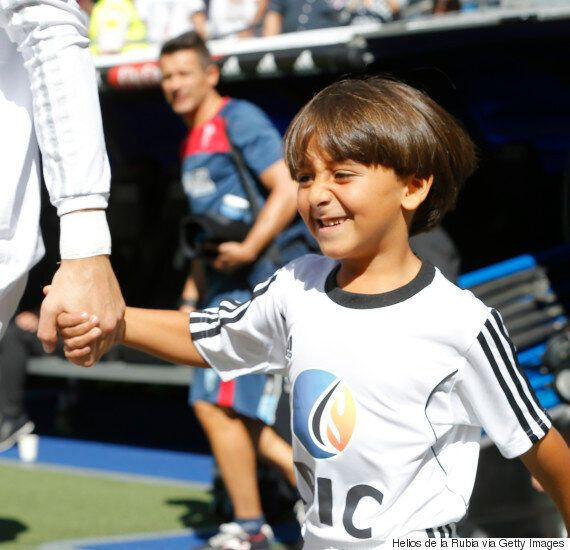Cristiano Ronaldo Leads Out Young Syrian Boy Tripped By Hungarian Camerawoman At Real Madrid