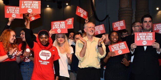 British Labour Party Leadership contender Jeremy Corbyn (C) poses for pictures with supporters after...