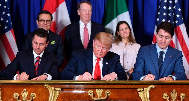 Mexico's President Enrique Pena Nieto, President Donald Trump and Prime Minister Justin Trudeau sign...
