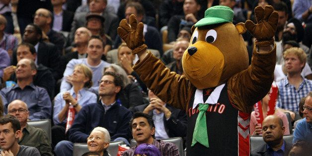 TORONTO, CANADA - OCTOBER 31: A fan dressed up as Yogi the Bear for Halloween cheers as the Indiana Pacers...