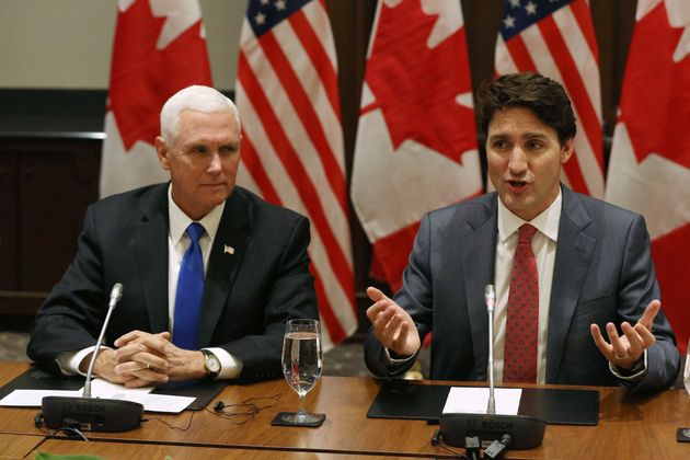 Vice President Mike Pence and Prime Minister Justin Trudeau attend a meeting for the US-Mexico-Canada...