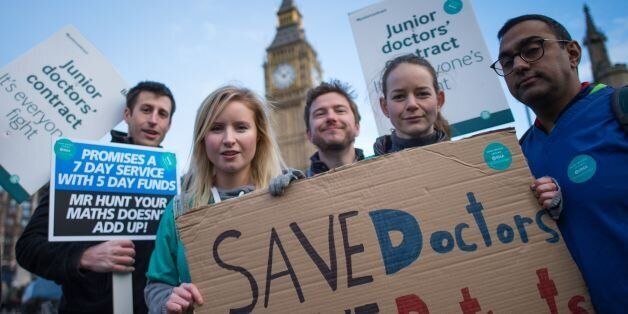 Junior doctors and medical students demonstrate outside the Houses of Parliament in London as part of...