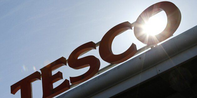 A Tesco logo is pictured at a supermarket in west London on April 22, 2015. Britain's biggest retailer,...