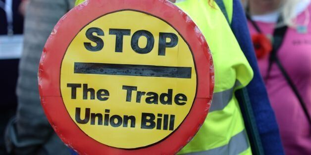 TUC members queue outside the Houses of Parliament to lobby against the Trade Union Bill,