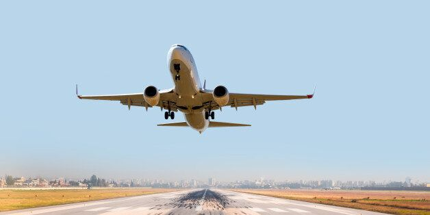 passenger plane fly up over take-off runway from