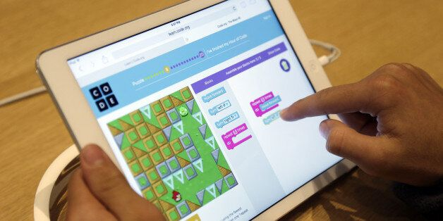 Matthew Triska, 13, learns to build code using an iPad at a youth workshop at the Apple store on Wednesday,...