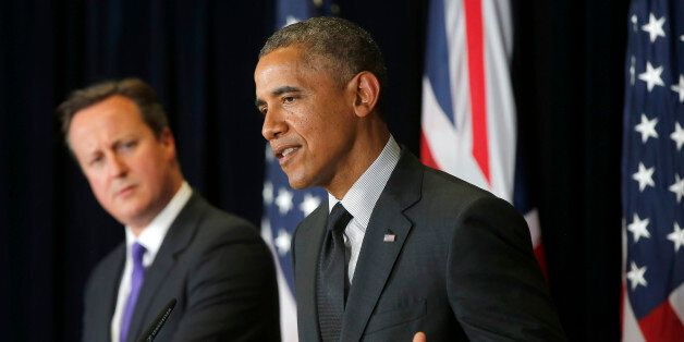 President Barack Obama and British Prime Minister David Cameron participate in a news conference at the...