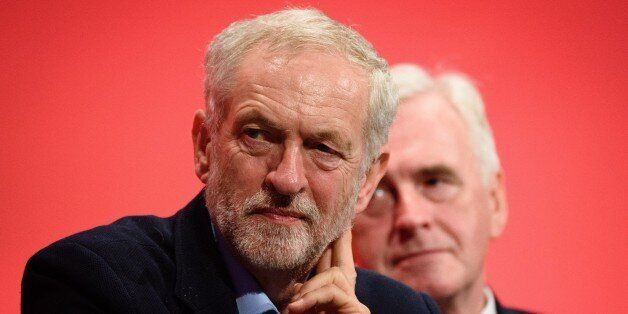 Leader of the opposition Labour Party Jeremy Corbyn (L) sits by shadow chancellor John McDonnell on day...