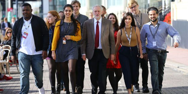 Jeremy Corbyn arriving with supporters at the Brighton Centre in Brighton, Sussex to make his first speech...