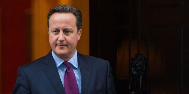 Prime Minister David Cameron prepares to meet Queen Rania of Jordan (not pictured) outside 10 Downing...