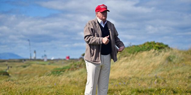 Republican Presidential Candidate Donald Trump drives a golf buggy during his visits to his Scottish...