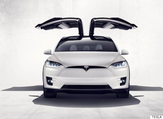 Tesla Unveils Model X Electric Family Car With Falcon Wing Doors And Bio Weapon Defense