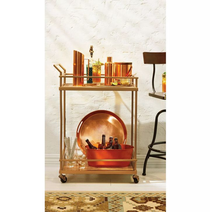 "Get <strong><a href=""https://fave.co/2MJrCv0"" target=""_blank"" rel=""noopener noreferrer"">this wood and glass gold-finished rolling bar cart for 25% off</a></strong>&nbsp;at Target today only."