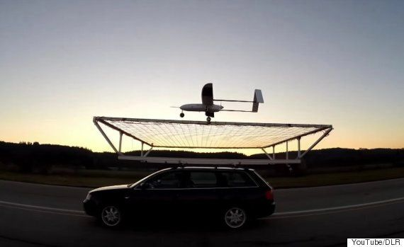 A Drone Has Landed On A Moving Car In