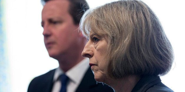 Prime Minster David Cameron and Home Secretary Theresa May speak to Home Office Immigration Enforcement...