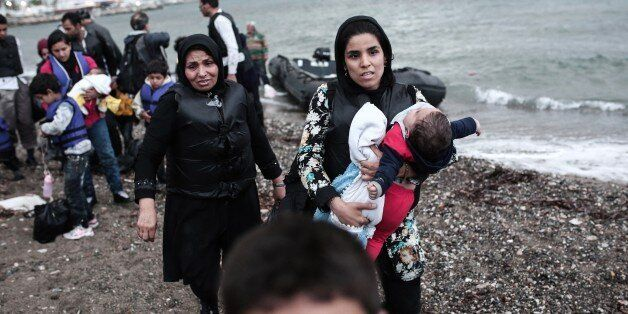 Afghan migrants arrive on a beach on the Greek island of Kos, after crossing a part of the Aegean Sea...