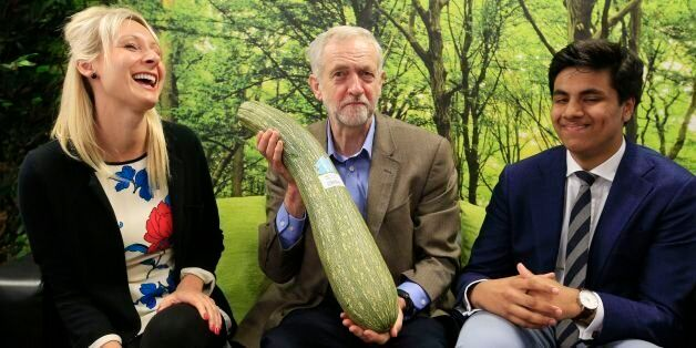 Labour party leader Jeremy Corbyn (centre) is presented with a marrow by local independent store 'HiSbe'...