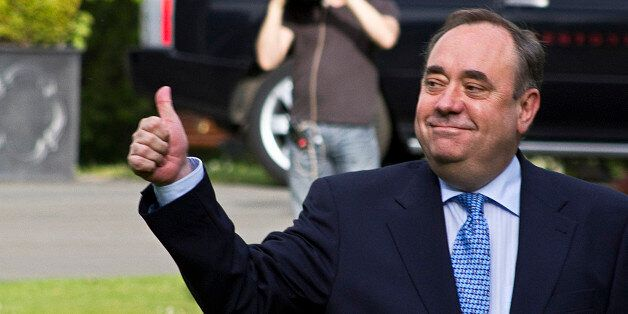 Scottish First Minister Alex Salmond gives the thumbs up as he arrives at the Prestonfield Hotel in Edinburgh,...