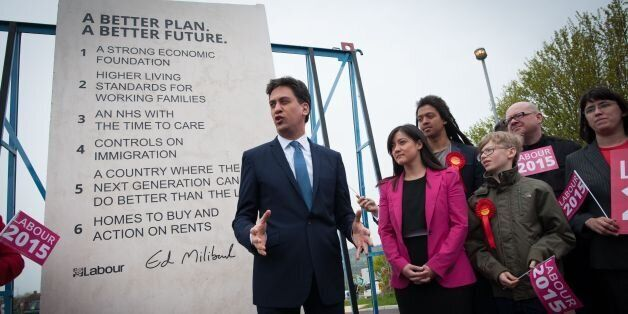 Labour leader Ed Miliband unveils Labour's pledges carved into a stone plinth in Hastings during General...