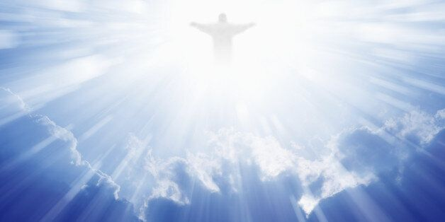 Jesus Christ in blue sky with clouds, bright light from heaven, resurrection,