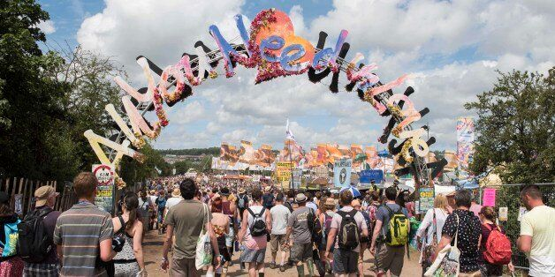 Festival goers walk across the Glastonbury site, on day 3 of Glastonbury festival 2015, Worthy Farm,