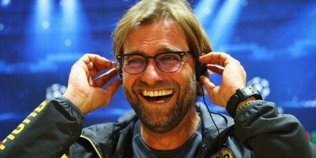 Jurgen Klopp manager of Borussia Dortmund laughs during a Borussia Dortmund press conference, ahead of...