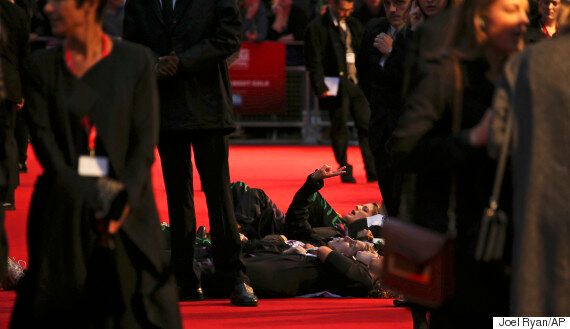 Suffragette Red Carpet Protest Sees Feminists Jump Barricades And Chant 'Domestic Violence Cuts